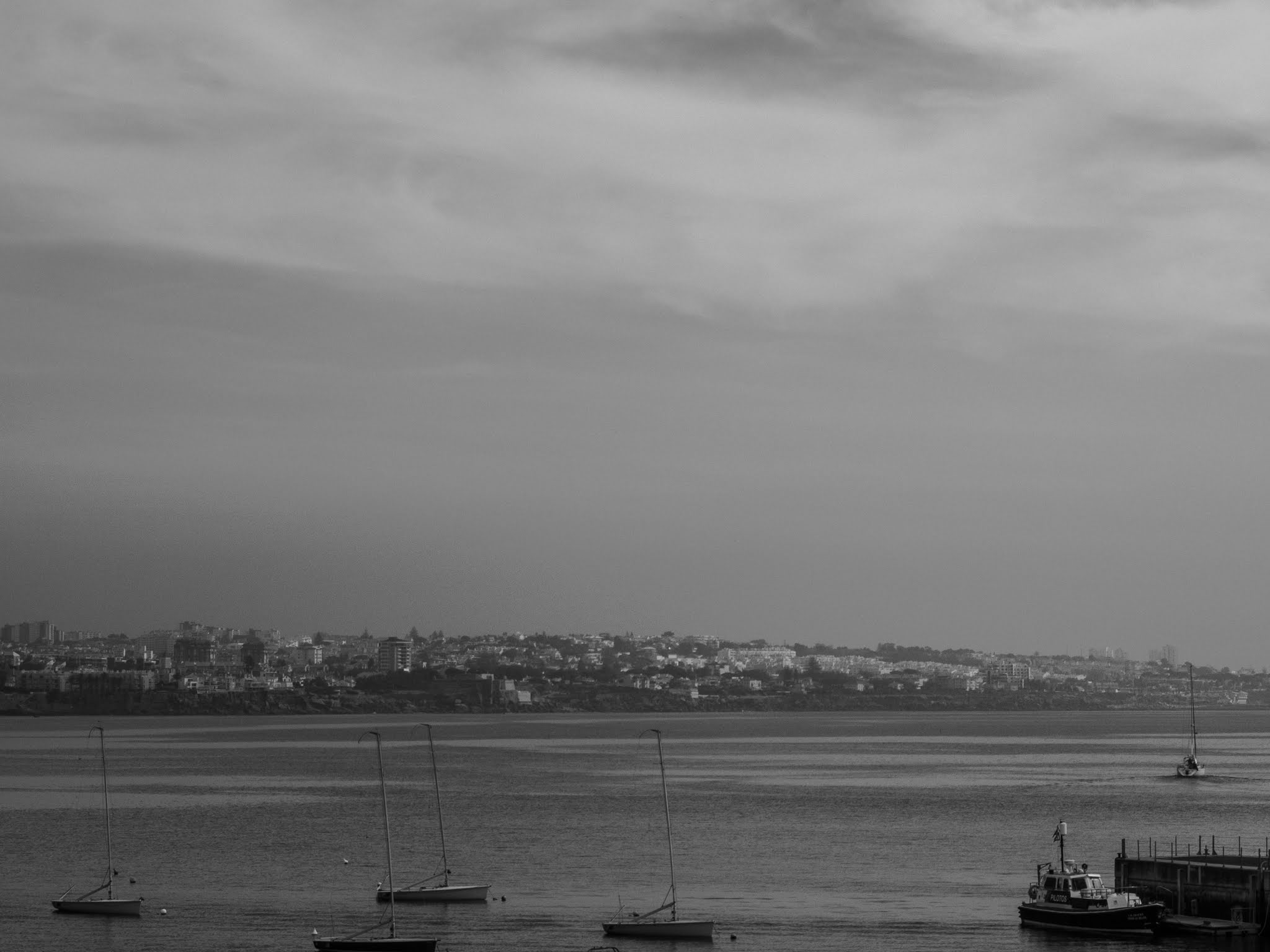 Caiscais bay in Portugal in black and white.