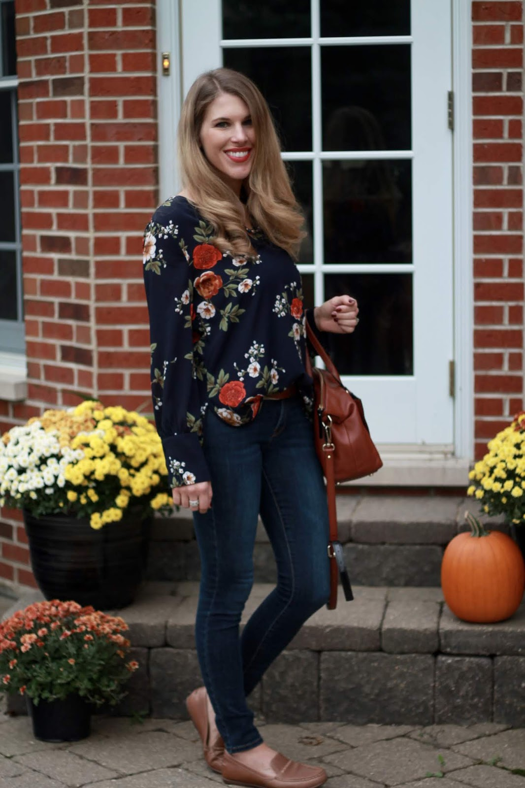 navy floral blouse, cognac loafers, cognac satchel, skinny jeans, casual fall outfit