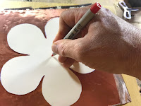 Marking the center of the flower on the aluminum sheet