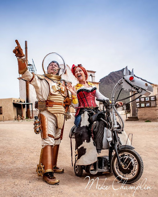 cosplayers dressed as steampunk buzz lightyear and steampunk jessie from disney's toy story