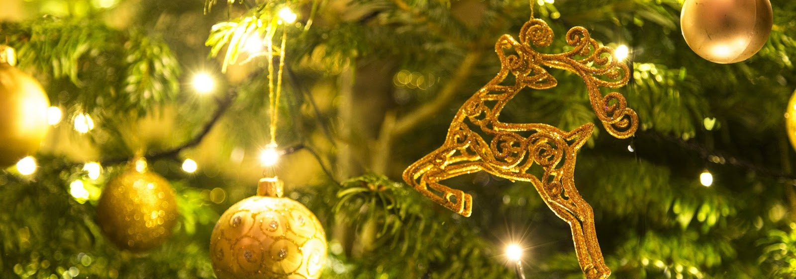gold baubles and gold reindeer tree decorations