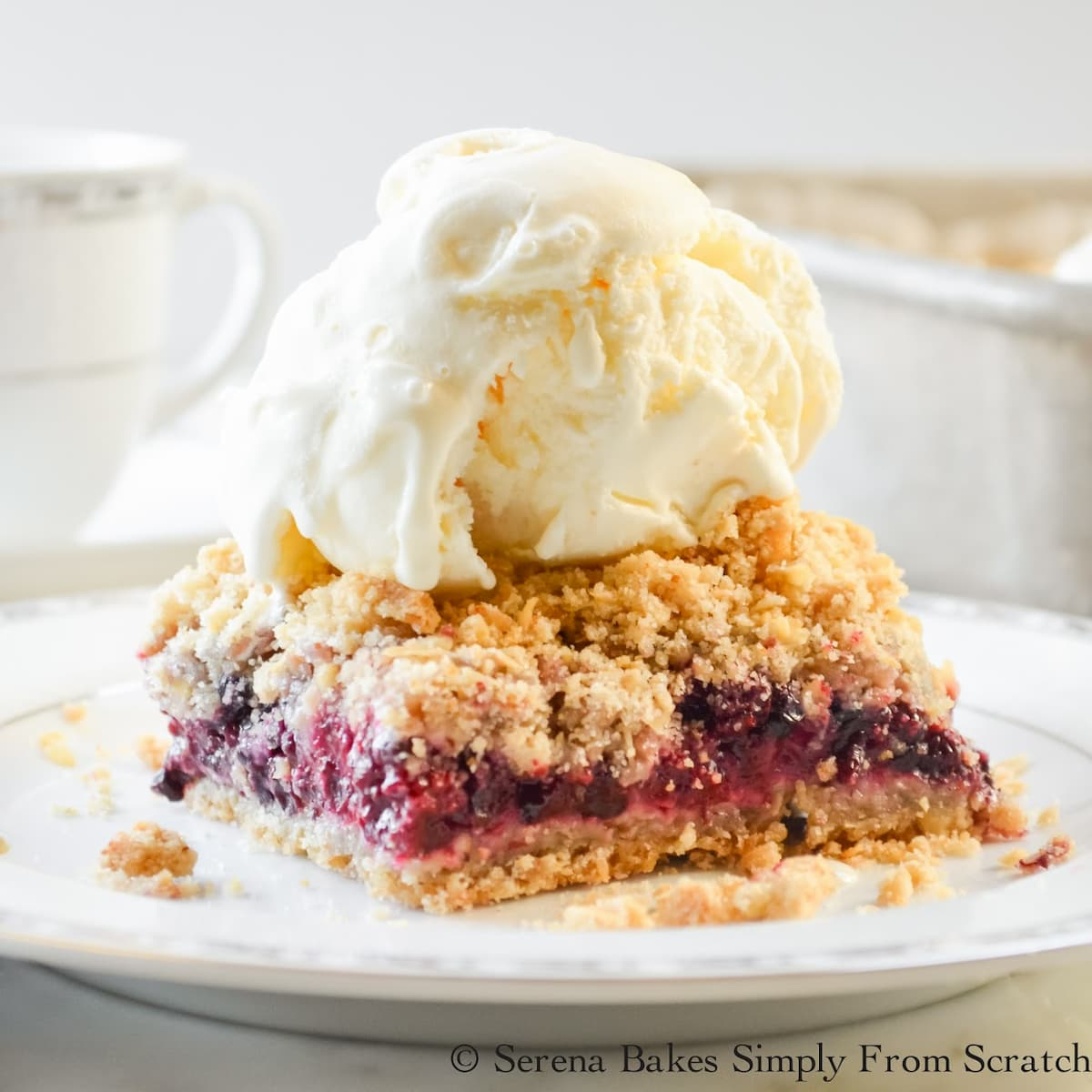Blackberry Crumb Bars with a scoop of vanilla ice cream from Serena Bakes Simply From Scratch.