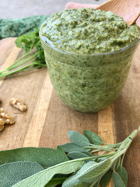 Finished jar of parlsey and sage walnut pesto.