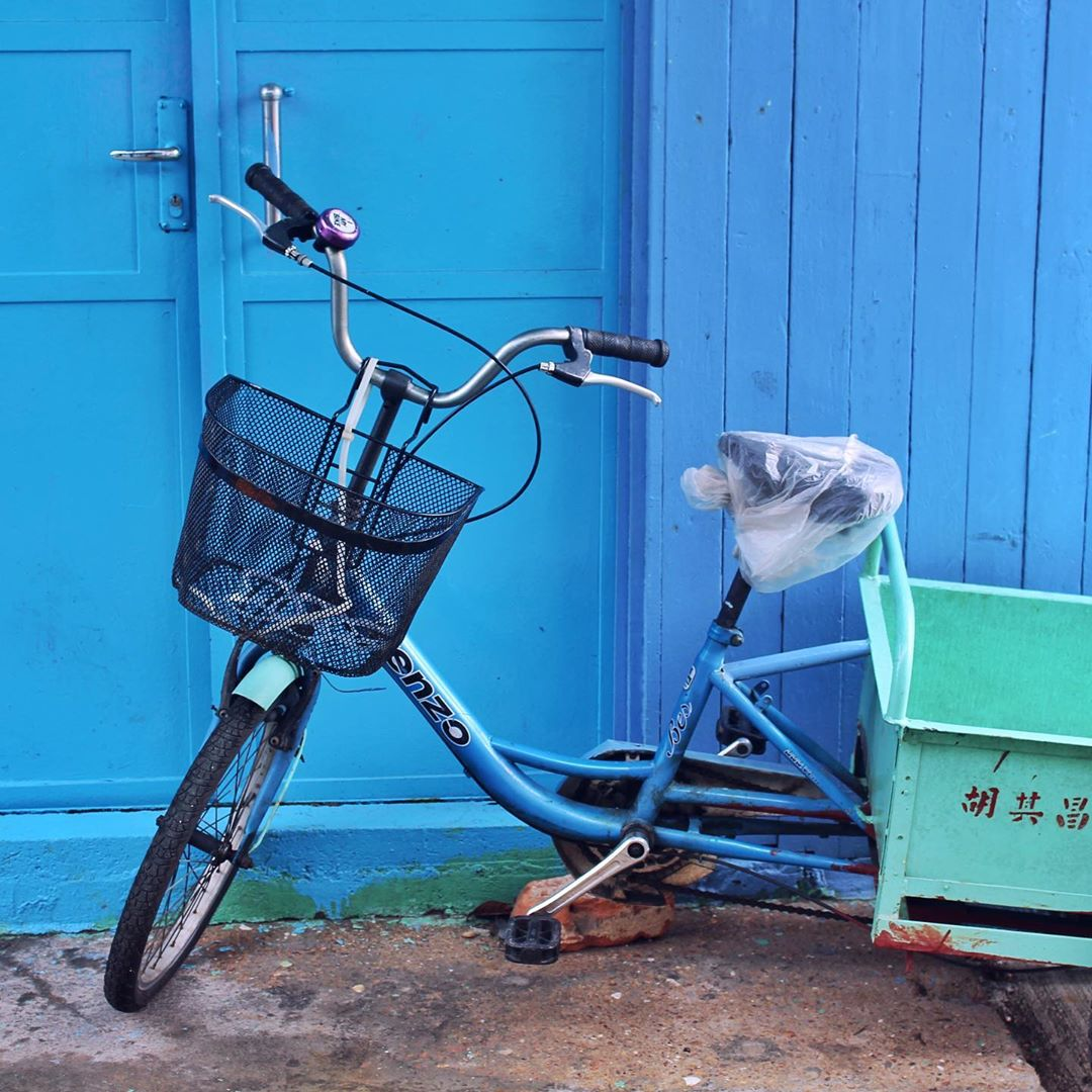 Charming, colourful blue house and bike in Tai O, Hong Kong - travel & lifestyle blog