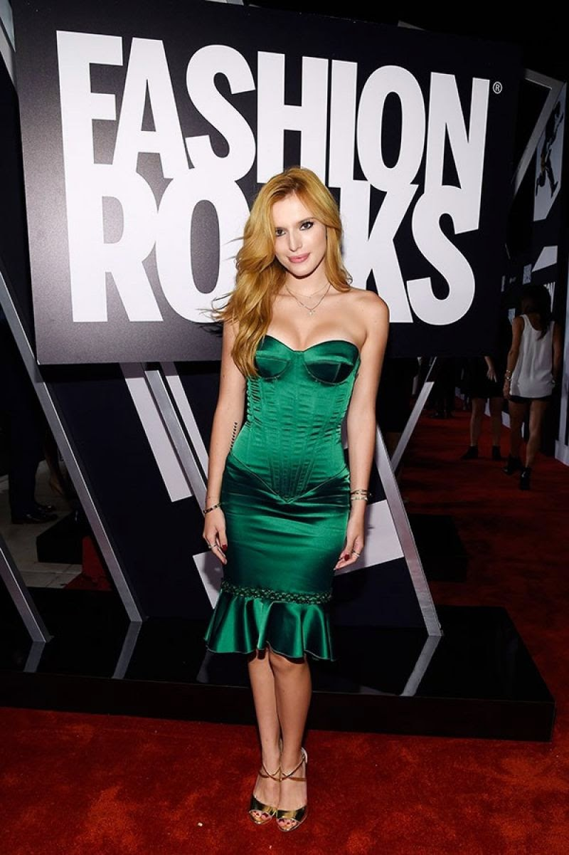 Bella Thorne bares cleavage in a strapless dress at the 2014 Fashion Rocks