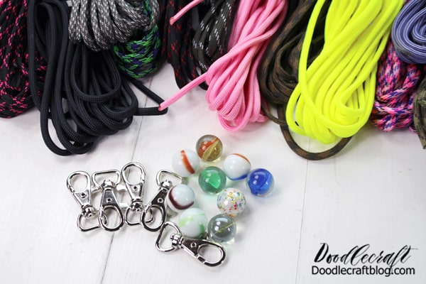 """Supplies Needed for Monkey Fist Keychains with Paracord: 6 feet of Paracord in various colors 1/2"""" Light Duty Metal Trigger Snap Marble Scissors Lighter"""