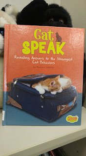 "A book titled ""Cat Speak"""