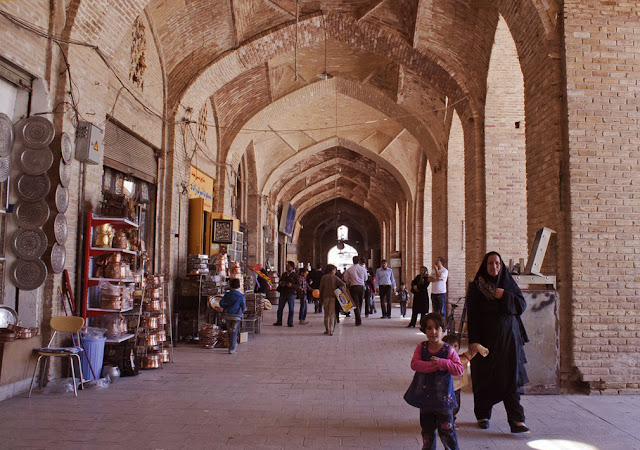 Locals walking through the Bazaar of Kerman. Iran