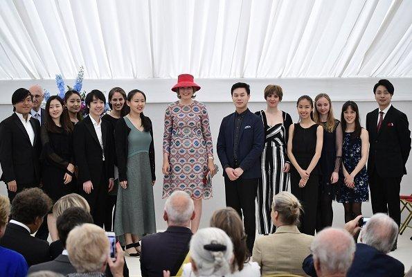 Queen Mathilde wore Natan print dress. Winner of the Queen Elisabeth Competition Stella Chen and Queen Mathilde