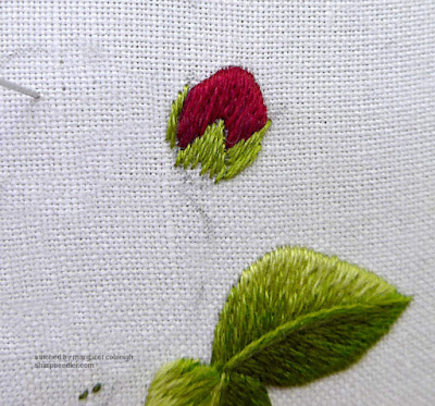 First row of sepals completed on needlepainted rose bud