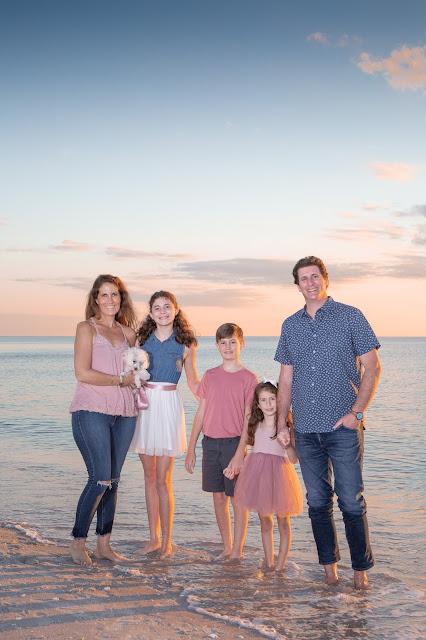 Florida family on the beach with dog