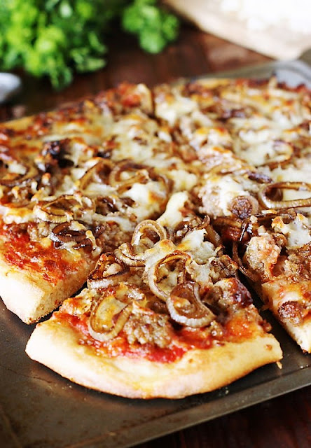 Slice of Sausage & Balsamic-Caramelized Onion Pizza Image