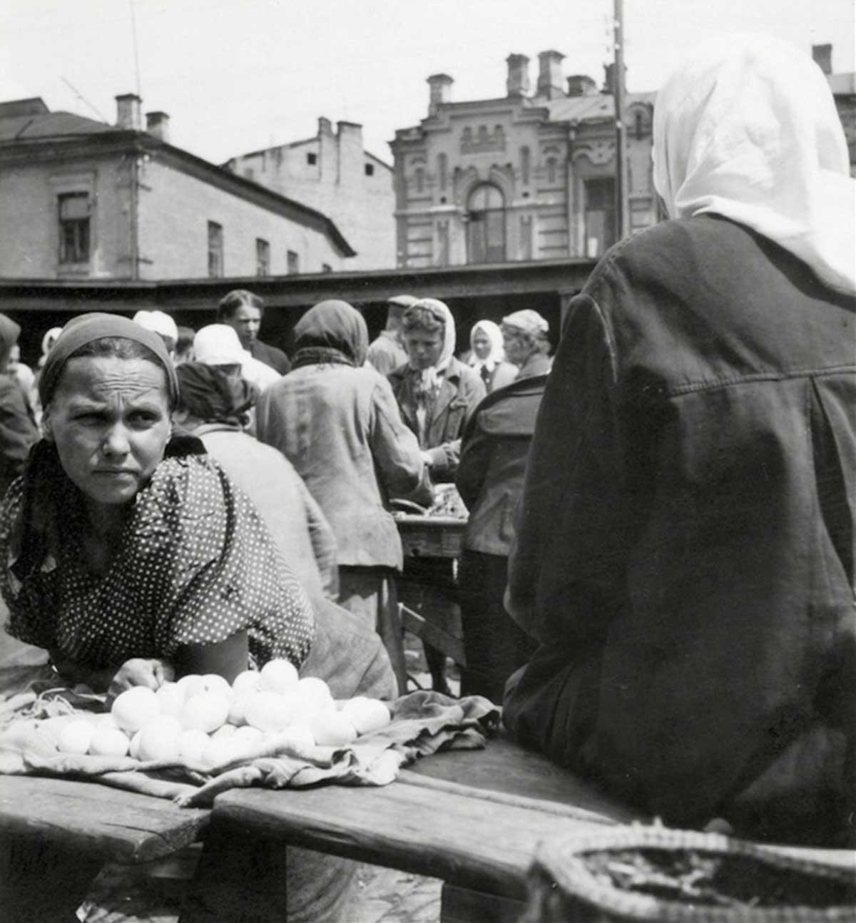 Farmer selling eggs on a market near Odessa. 1943.