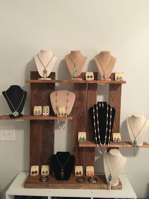 A jewelry display nook with necklace display busts and earring holders.