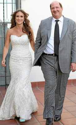 Celeste Ackelson with her husband Brian in their wedding dress