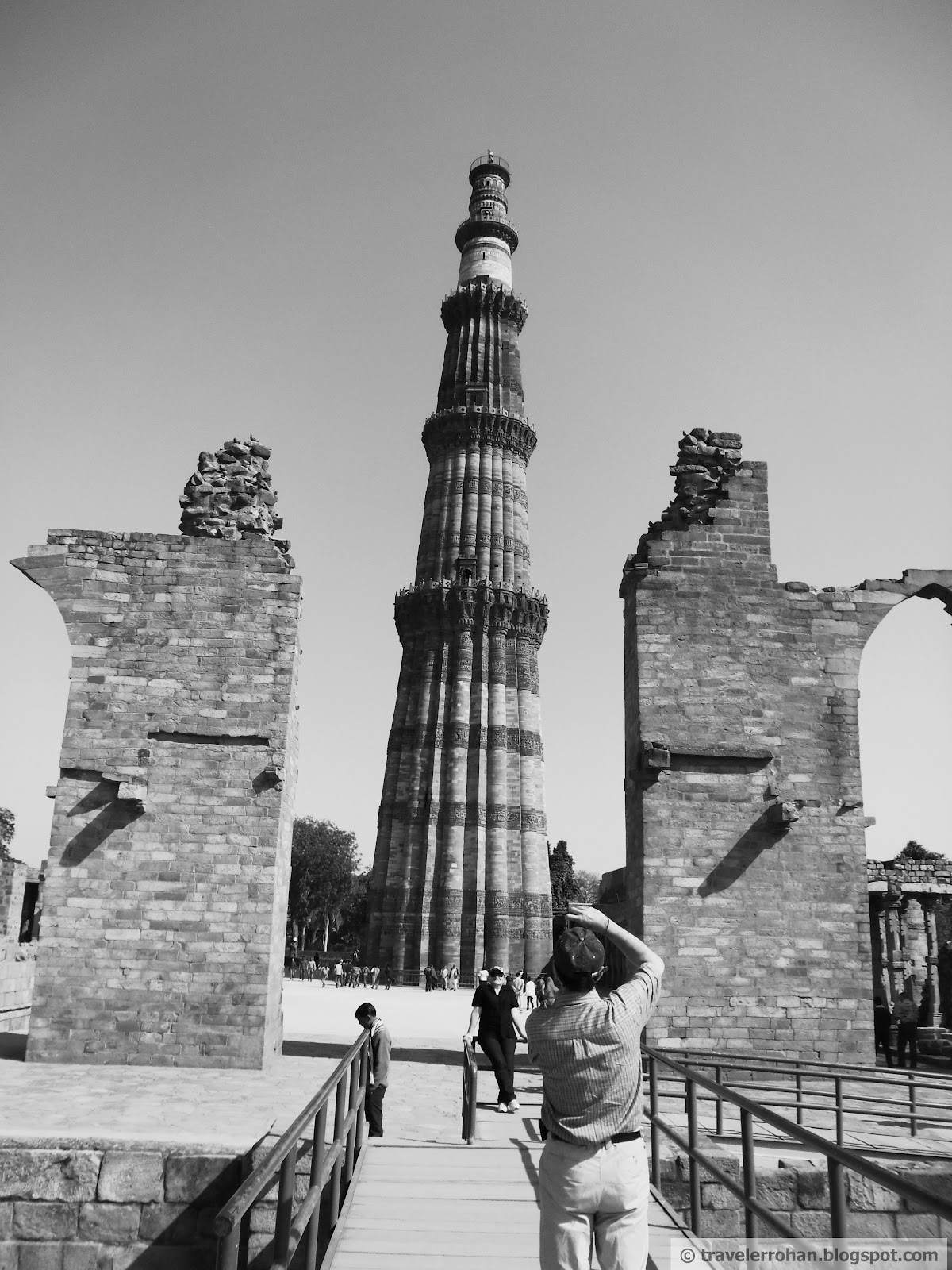 Qutb minar picture taken from amongst the ruins of quwwat ul islam mosque extended by iltutmish