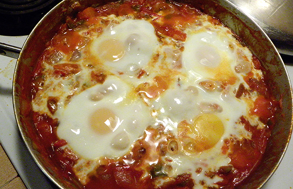 Eggs Poached in tomato sauce in skillet