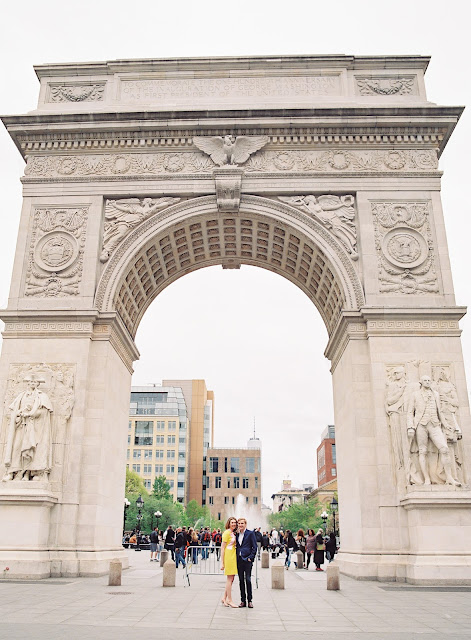 Liz and Ted pose under the arch at Washington Square Park in Greenwich Village Engagement Portraits