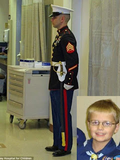 A Marine stands guard outside hospital room