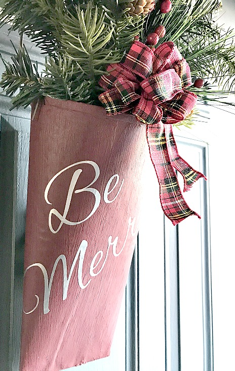 Christmas door spray in repurposed metal door pocket