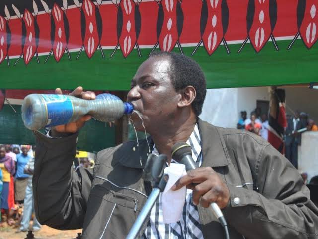 Former Magarini MP Harry Kombe drinking dirty water photo
