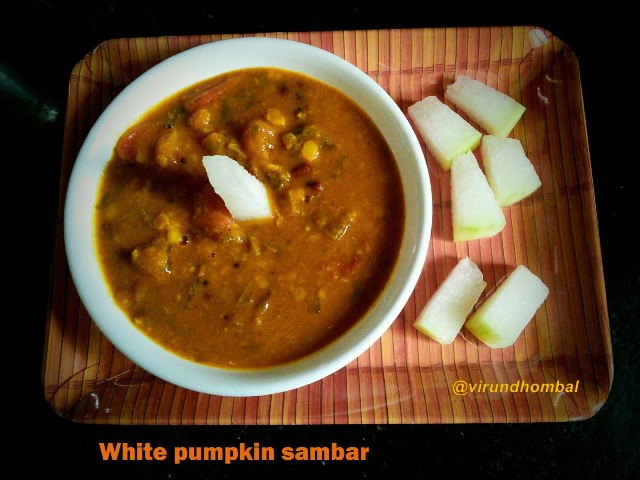 White Pumpkin(Ash gourd) Sambar/ Vellai poosanika Sambar White pumpkin sambar - Easy, flavourful and healthy dish with white pumpkins and karamani. You can prepare this sambar within 20 minutes. After preparing this sambar you can feel how a simple dish could turn into your favourite dish of the day.There is no need for peeling lots of onions or grinding any paste. Just little things like chopping the white pumpkins and cooking the dals. You may also substitute karamani (black eye beans) with any other cooked lentils depending on your preference. If you like an easy yet tasty dish you might prefer this White pumpkin sambar.