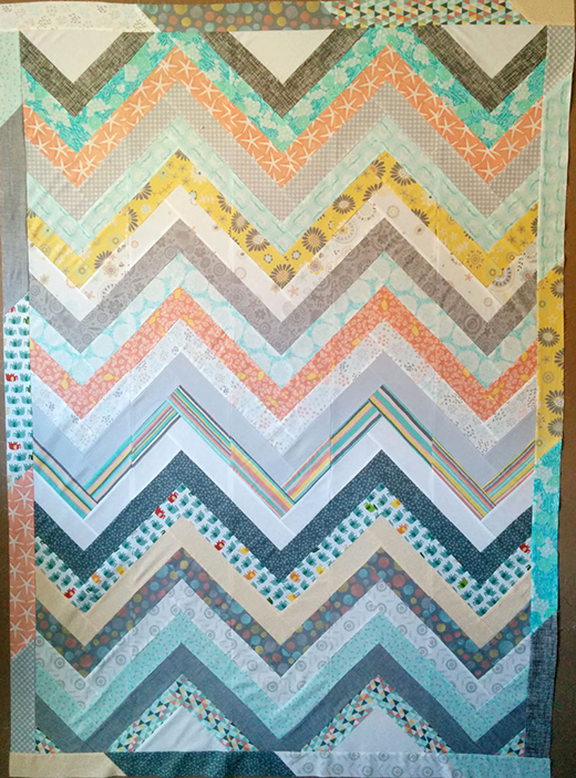 Easy Chevron Quilt Free Tutorial designed by Laura Ann Coia of Sew Very Easy
