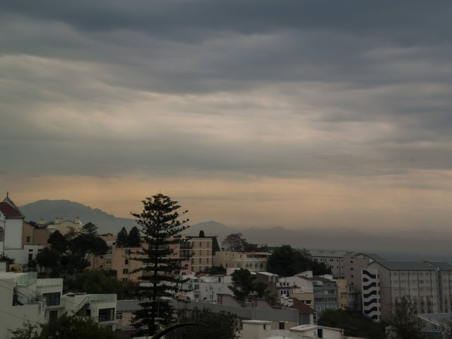 Hazy view of apartments and landscape of Gibraltar.