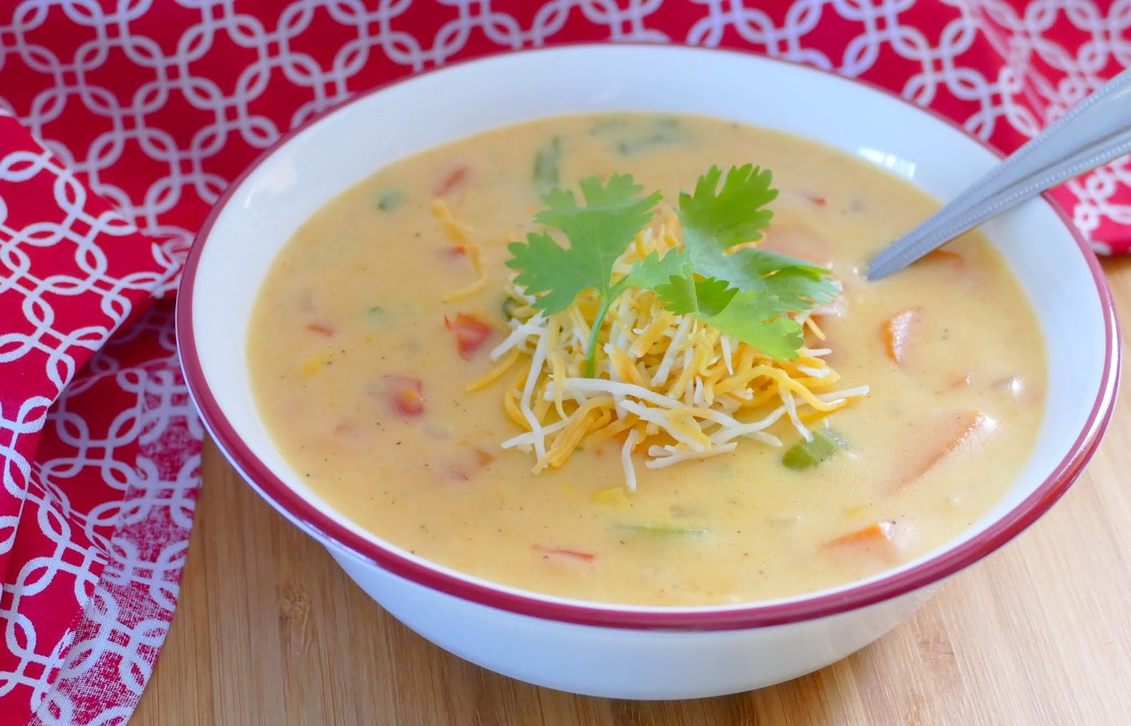 This easy, meatless soup is ready in 30 minutes! The Mexican flavors make this cheesy chowder absolutely delicious! The combo of carrots, celery, onion, bell pepper and corn make this soup so hearty! Add shredded rotisserie chicken if you're a meat lover!