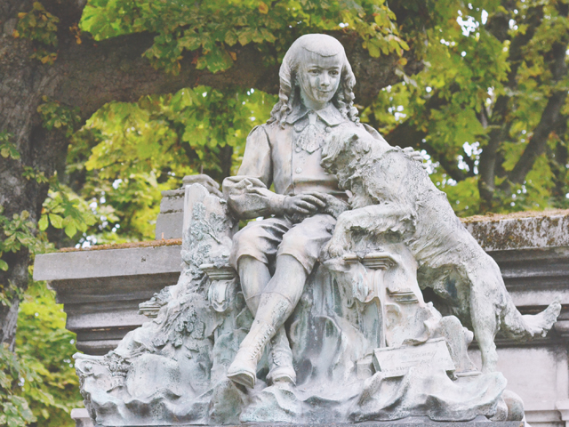 Statue of boy and dog at Pere Lachaise