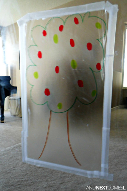 Preschool apple tree activity using contact paper and acrylic apples