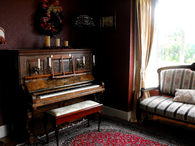 Seating area in the Dining room with an antique piano