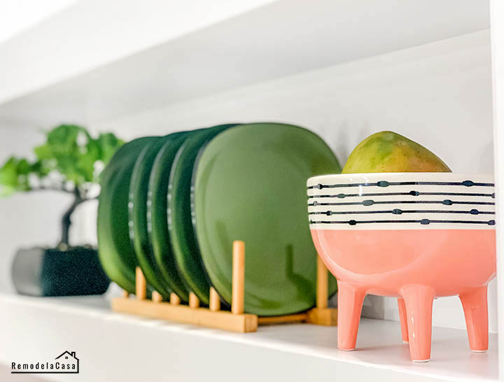 green dishes and pink footed bowl