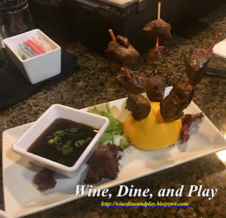 Some satay skewers with soy dipping sauce at the Melting Pot restaurant in St Petersburg, Florida