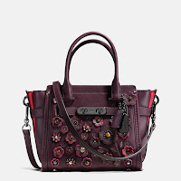 http://www.coach.com/coach-swagger-21-in-willow-floral/55523.html?dwvar_color=DKOXB&searchkeyword=floral swagger