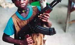 a small boy with gun