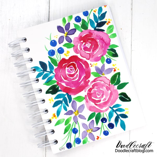 Make a notebook and leave the cover blank for the recipient to decorate--or design the cover like I did.