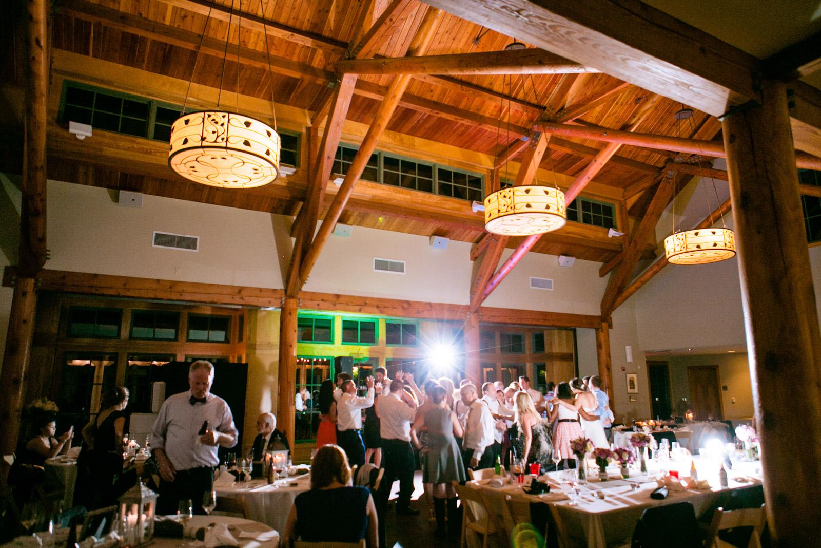 Inside the Dorris Duke Center at Duke Gardens in Durham North Carolina.  Guests dance on the dance floor after a good meal