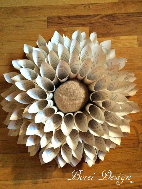 DIY tutorial on how to make a recycled book page wreath.