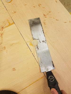 cutting the excess dowel ends with a hand saw