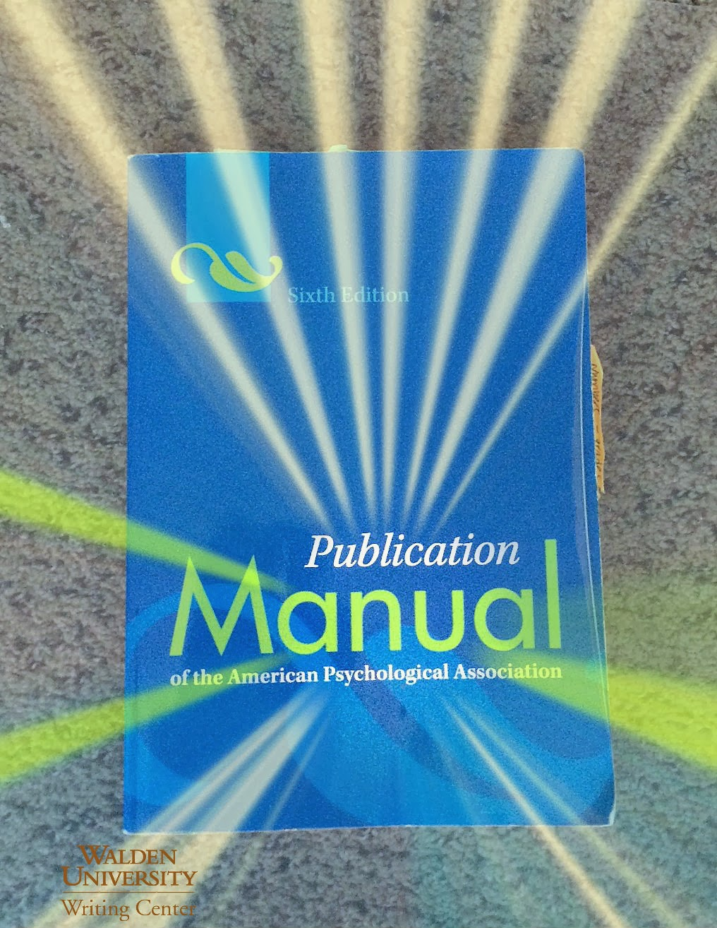 APA manual with sunbeams