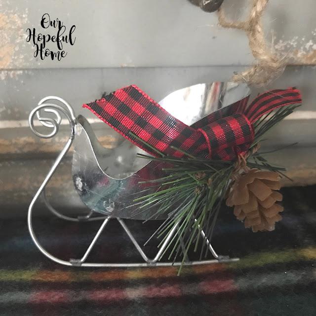 galvanized tin sleigh red buffalo check bow pine cone