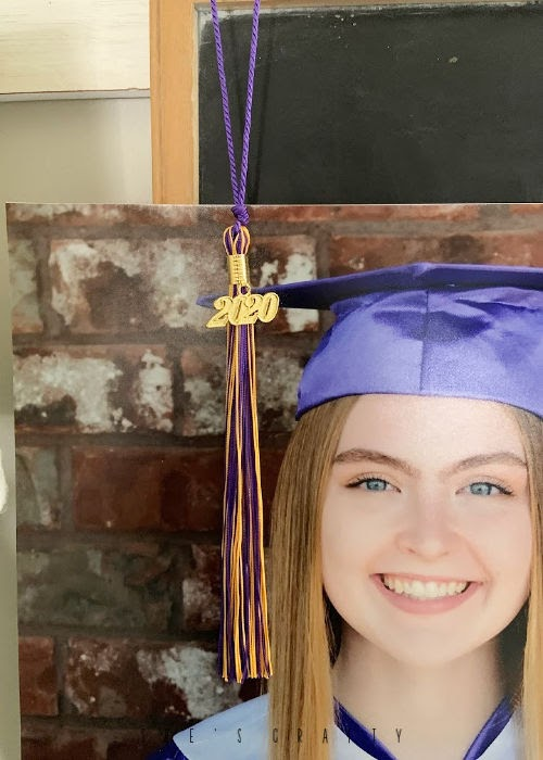graduation display at home for seniors  -  cap and gown photos