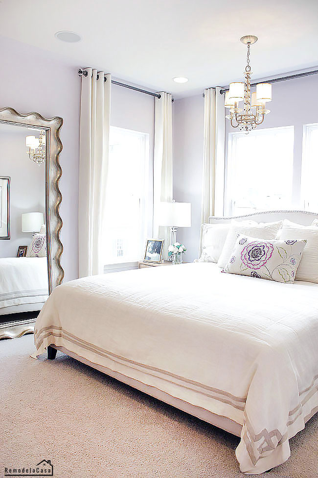 lilac and white Master bedroom with big mirror