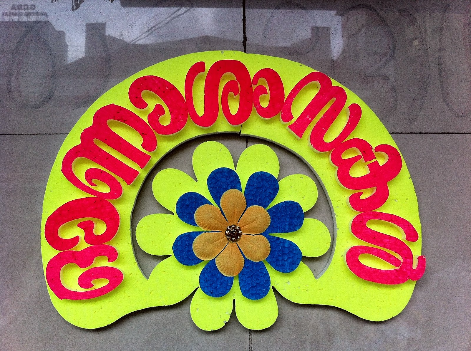 "This sign says ""Onaashamsakal"" in Malayalam. Ona (Onam), asahamsakal (wishes.)"