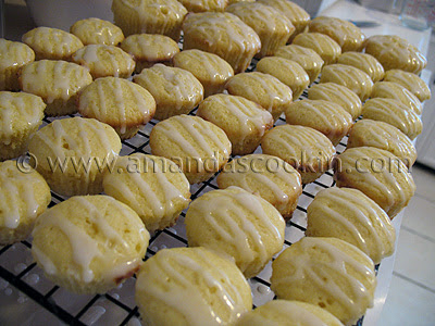 A close up photo of lots of German mini lemon cakes resting on a cooling rack.