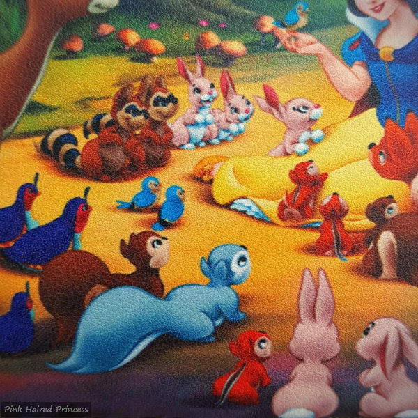 squirrels, bunnies, racoons, chipmunks and birds in scene from Snow White on back of bag