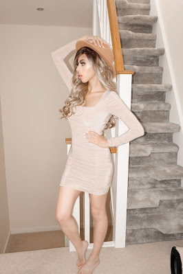 The Femme Luxe Nude Square Neck Ruched Bodycon Mini Dress in model Gina.