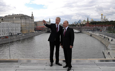 Russian President Vladimir Putin and Moscow Mayor Sergei Sobyanin.