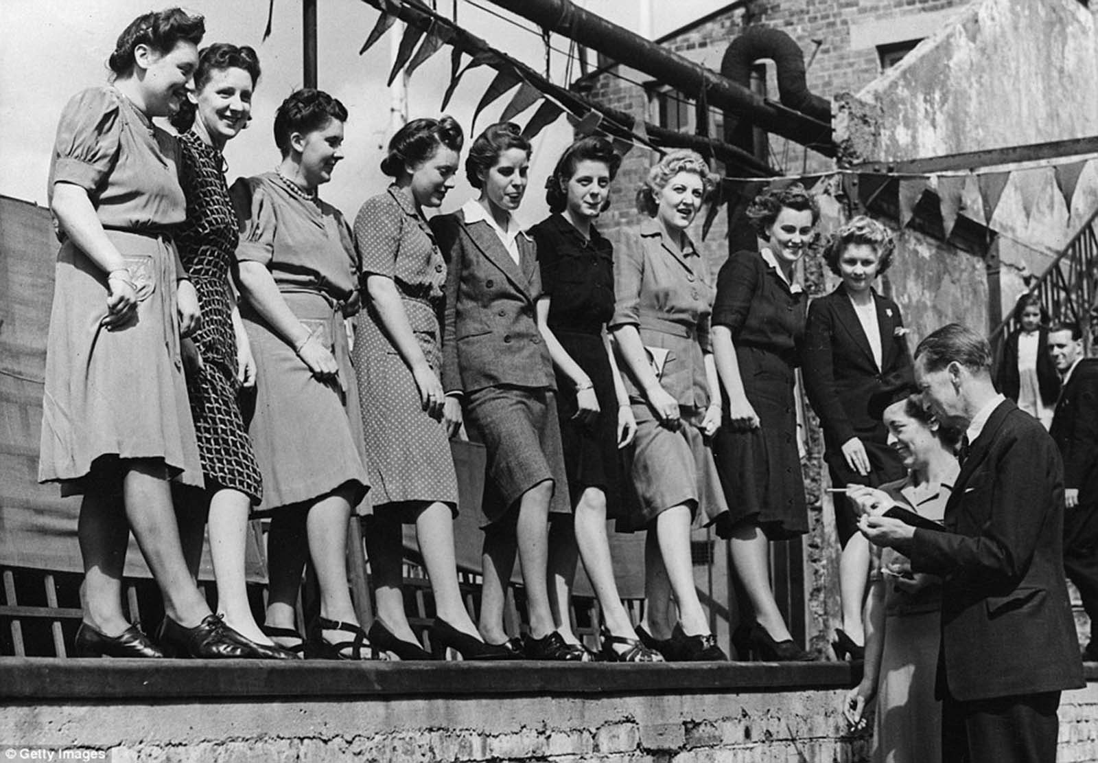 The ankle judging competition at Selfridges department store's annual sports meeting on the roof of the shop's building in London's Oxford Street in 1943.